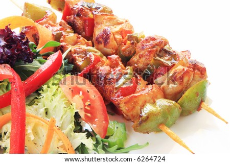 Chicken and vegetable kebabs with mixed green salad.