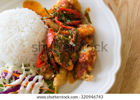 chicken fried in a spicy sauce and rice, Thai.select focus