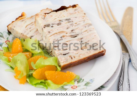 Chicken galantine stuffed with pancakes, meat and mushrooms