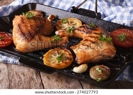 Chicken legs grilled on a grill pan close-up. horizontal, rustic style