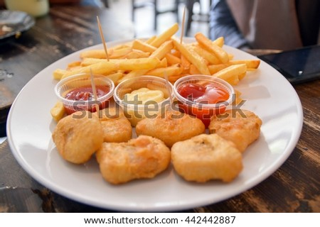 Chicken Nuggets with French Fries, Close up.
