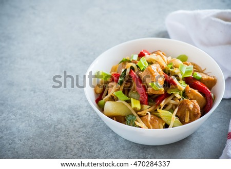 Chicken stir fry with bell peppers, bean sprouts and bok choy in a bowl. Chicken kung pao with vegetables, selective focus, horizontal, copy space