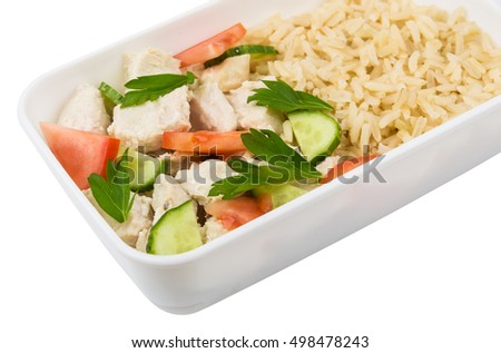 Chicken with brown rice and vegetables in plastic container isolated on white background