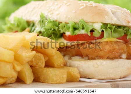 Chickenburger chicken burger hamburger with fries closeup close up tomatoes cheese unhealthy