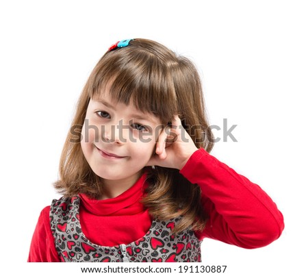 Child doing a telephone gesture over white background