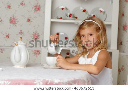 Child drink tea at home.