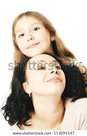 Child girl and mother playing. Portrait of woman with daughter