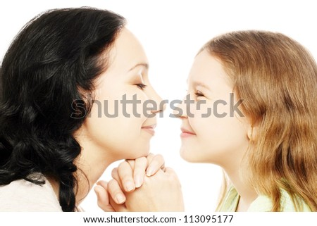 Child girl and mother playing. Smiling profile of woman with daughter