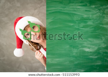 Child holding banner. Kid hiding behind card blank. Christmas Xmas winter holiday concept