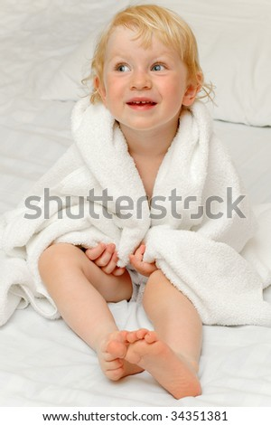Child in white towel