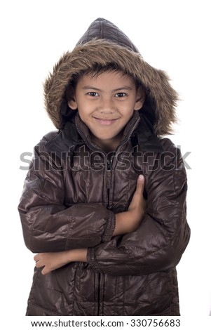 child in winter coat on white background