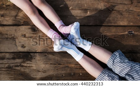 Child legs in colorful striped socks