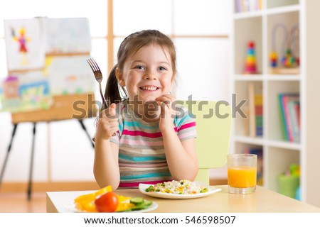 child little girl with fork ready to eat