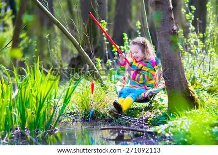 Girl boy doll statue sitting swing stock photo 288919019 for Little kid fishing pole