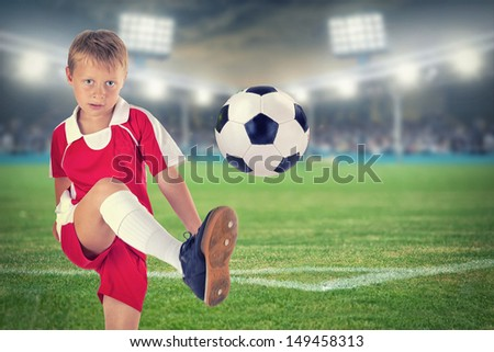 child Plays Soccer with professional Equipment, Soccer Stadium background