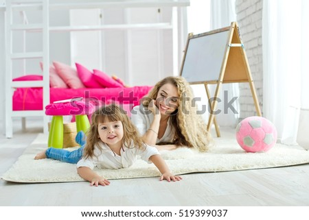 Child plays with mother