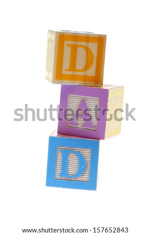 Child's wooden blocks with letters spelling DAD