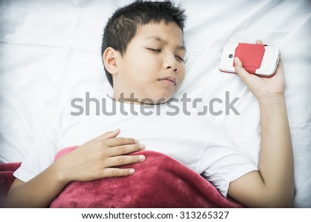 Child sleeping with phone