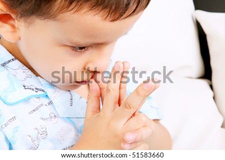 Child with his hands in prayer position