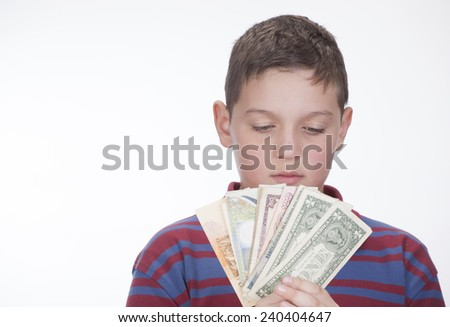 Child with money on white background