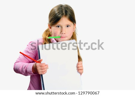 child with pencil and drawing pad