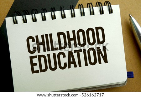 Childhood education memo written on a notebook with pen