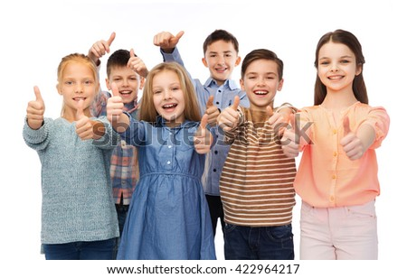 childhood, fashion, gesture and people concept - happy smiling children showing thumbs up