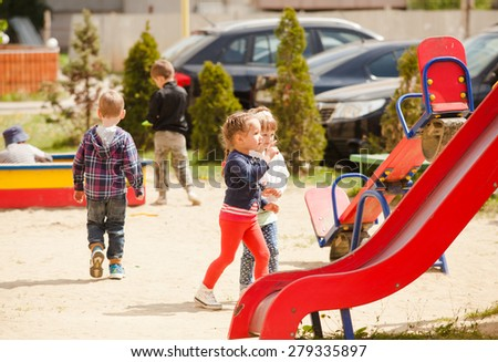 Children are playing at the playground outdoors