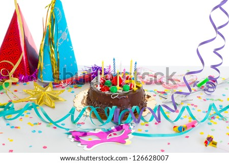 Children birthday party with chocolate cake confetti garland and serpentine