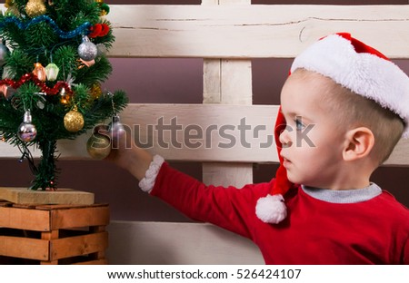 Children in Christmas clothes and santa hat. Christmas decoration.