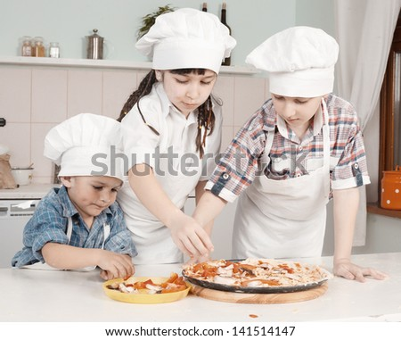 Children in clothes cooks