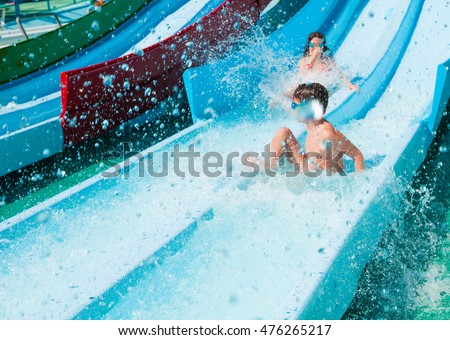 Children on water slide in aqua park