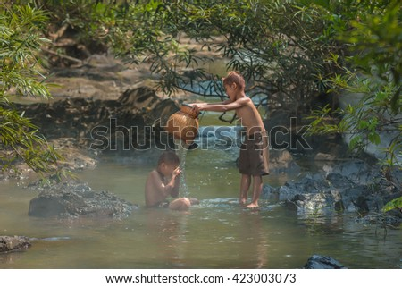 Children playing in the waterfall.