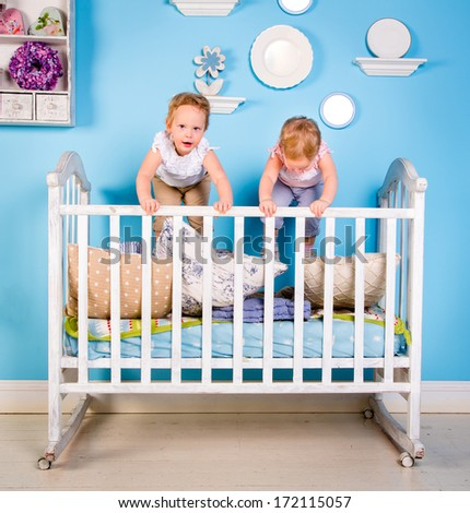 Children playing on bed