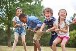 children playing tug of war at the park - Children Images Free