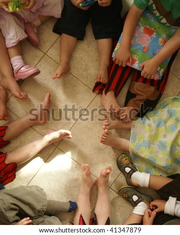 Children's feet in a circle at a birthday party