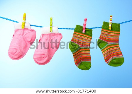 children's socks on a rope on a blue background