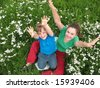 Children the lifted hands upwards - stock photo