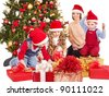 Children with gift box near Christmas tree. Isolated. - stock photo