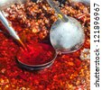 chili sauce with oil in the container - stock photo