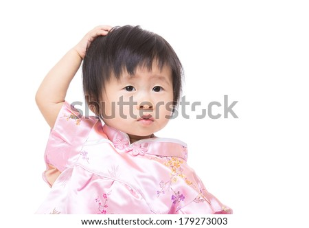 Chinese baby girl touch her hair