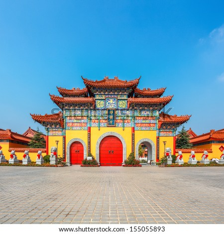 chinese buddhist temple doors with square with blue sky,gatehouse closeup