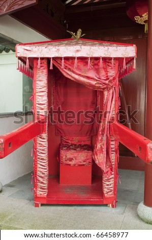 Chinese carriage or litter with silk curtain and baldachin decorated with tassels