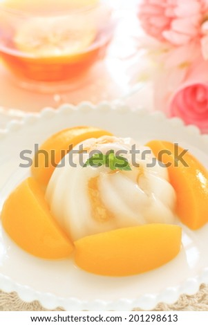 Chinese dessert, Agar Jelly and peach with english tea on background