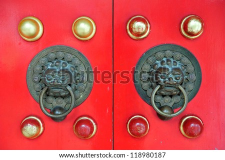 Chinese door in red with decoration from Hong Kong Temple.