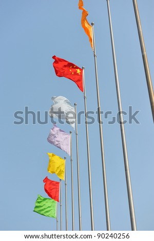 Chinese flag and many other colorful flags.