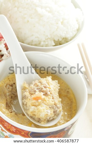Chinese food, steamed mince and dried shrimp in egg with rice