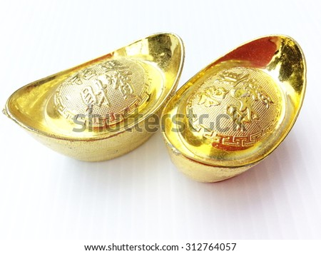 Chinese gold ingot isolated on white background