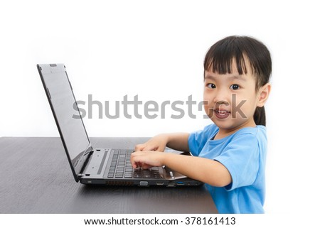 Chinese little girl using laptop in plain isolated white background.