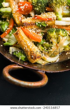 Chinese stir fry vegetables in wok. With space for copy